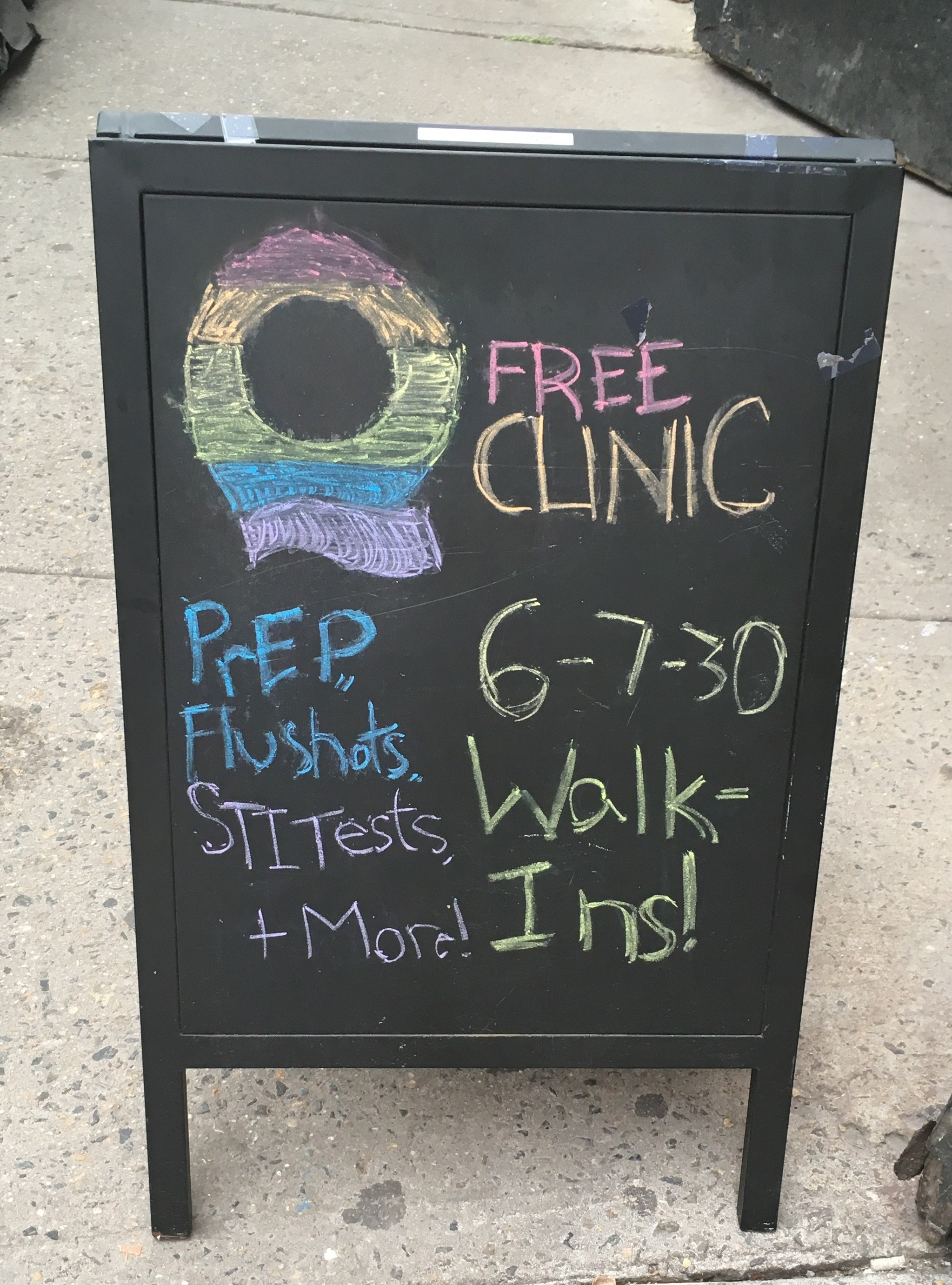 chalkboard outside of Q Clinic advertising services